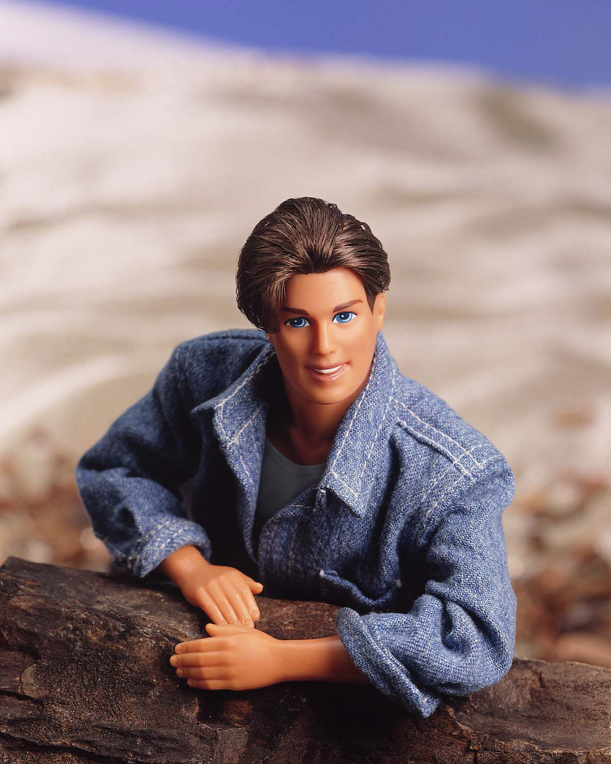 386688 04: (FILE PHOTO) A 1995 Ken doll wears a jean jacket in this portrait. On March 13, 2001, Mattel toy company celebrated the 40th anniversary of the Ken doll which was originally introduced March 13, 1961 at the American International Toy Fair. Originating with his crew cut look and evolving through the funky disco styles of the ''70s and ''80s, to the trendy styles of the ''90s, Ken has been a worldwide pop culture favorite for every era and for several generations. (Photo courtesy of Mattel/Newsmakers)