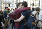 A gay couple kisses as people gather to celebrate after the French parliament approved a law allowing same-sex couples to marry and to adopt children, in Paris April 23, 2013. French lawmakers passed a bill on Tuesday, a flagship reform pledge by the French president which sparked often violent street protests and a rise in homophobic attacks. The law legalises gay marriage and gives gay and lesbian couples adoption rights.   REUTERS/Charles Platiau  (FRANCE - Tags: POLITICS SOCIETY) - RTXYX5I