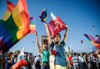 "TOPSHOT - People wave LGBT rainbow flags at Istanbul's Taksim Square as they take part in a political demonstration on July 24, 2016. Many thousands of flag-waving Turks massed on July 24, 2016, for the first cross-party rally to condemn the coup attempt against President Recep Tayyip Erdogan, amid an ongoing purge of suspected state enemies. Several banners also protested the post-coup state of emergency, with one proclaiming ""No to the coup, no to dictatorship"" and another saying ""Turkey is secular and will remain so"". The mass event was called by the biggest opposition group, the secular and centre-left Republican People's Party (CHP), many of whose members carried pictures of modern Turkey's founding father Mustafa Kemal Ataturk. / AFP PHOTO / OZAN KOSEOZAN KOSE/AFP/Getty Images"