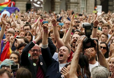People react as Ireland voted in favour of allowing same-sex marriage in a historic referendum, in Dublin May 23, 2015. Ireland became the first country in the world to adopt same-sex marriage by popular vote as 62 percent of the electorate backed a referendum, official results showed on Saturday.  REUTERS/Cathal McNaughton  - RTX1E99N