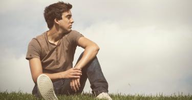 sad-guy-on-grass