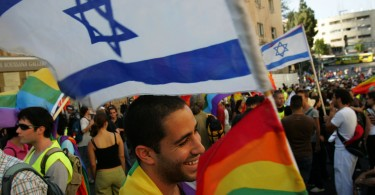 JERUSALEM, ISRAEL - JUNE 21: Israeli gay activists fill a downtown street during the gay pride parade June 21, 2007 in Jerusalem. Some 3,500 people marched about 500 meters down a central Jerusalem street in the much-contested parade as about 8,000 Israeli police protected them from threats by ultra-Orthodox Jews to disrupt the march. (Photo by David Silverman/Getty Images)