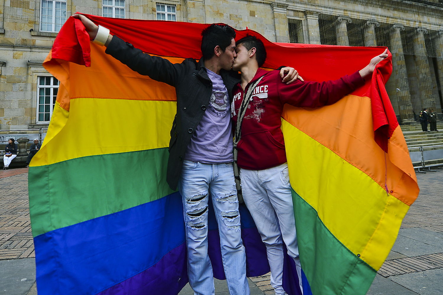 A gay couple kisses during a protest by the lesbian, gay, transgender and bisexual (LGTB) community demanding for their rigths --including gay marriage-- at the Bolivar Square in Bogota on November 27, 2012.    AFP PHOTO/Luis Acosta        (Photo credit should read LUIS ACOSTA/AFP/Getty Images)