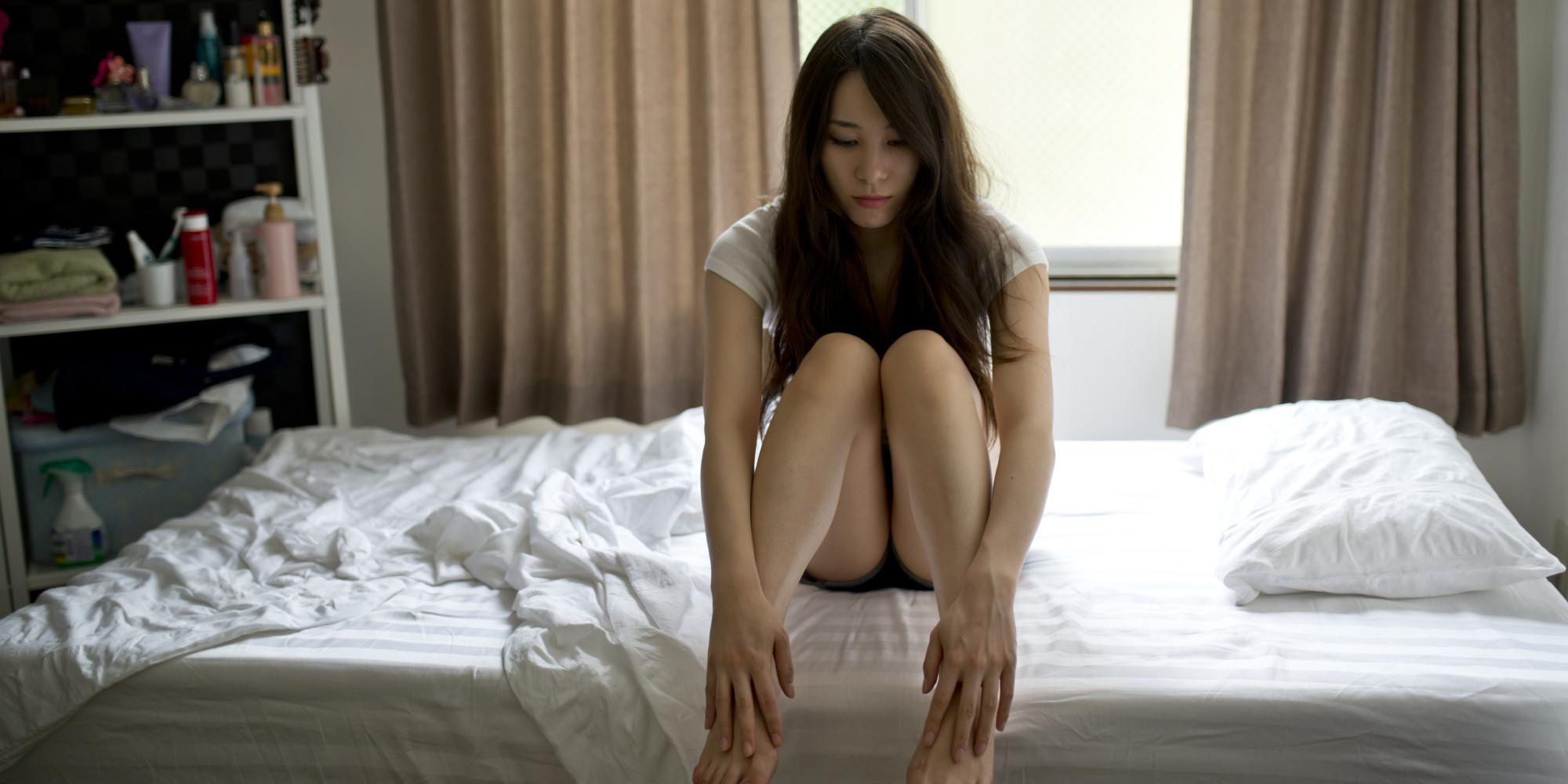 o-sad-woman-bedroom-facebook