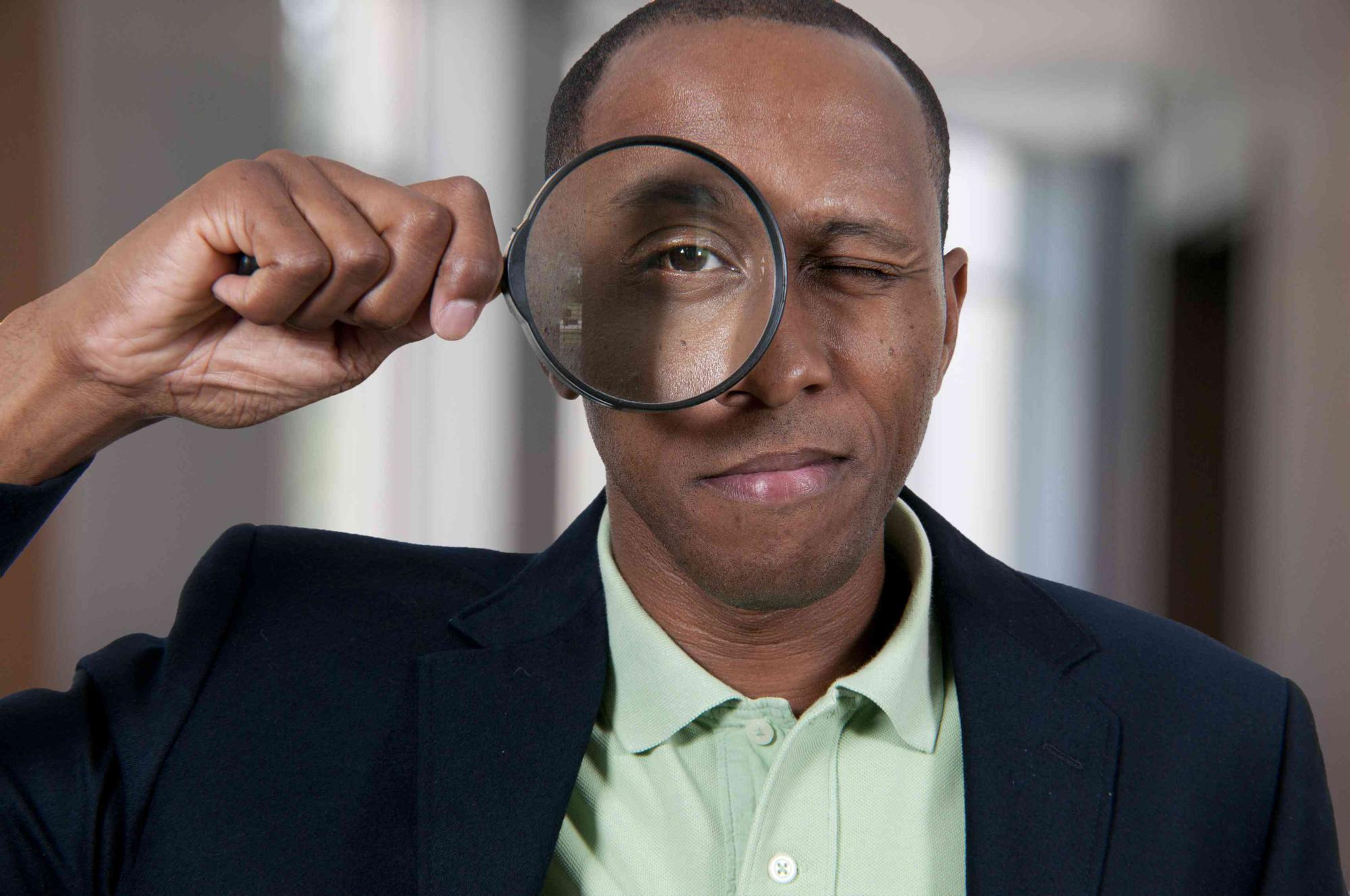 bigstock-Black-Man-Looking-Through-A-Ma-37502563-c-r