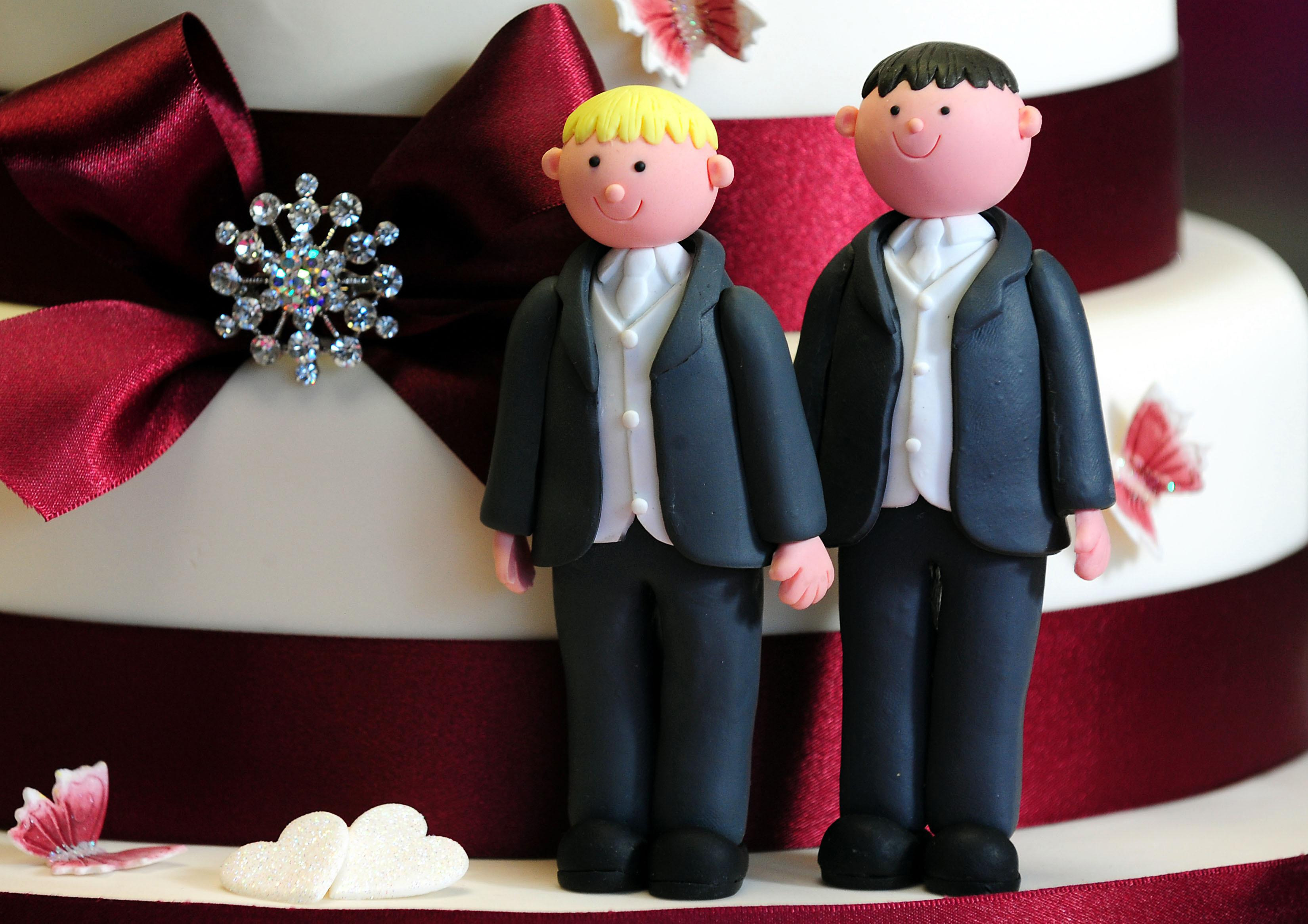 """File photo dated 05/02/13 of a general view of groom cake decorations on a wedding cake as plans to allow gay marriage look set to overcome their latest parliamentary hurdle this evening after Labour and the Government signalled they were ready to work together to defeat a backbench bid to wreck the legislation in the House of Commons.. Issue date: Tuesday May 21, 2013. A source close to Culture Secretary Maria Miller said she was """"very relaxed"""" about a Labour proposal for an immediate consultation on extending civil partnerships to heterosexual couples, designed to defuse Tory backbench demands for straight couples to be given equality with homosexuals and lesbians in this area. The deal means that the first same-sex marriages could take place as early as next summer if the Marriage (Same Sex Couples) Bill clears the House of Lords, where it is expected to meet stiff resistance. See PA story POLITICS Gay. Photo credit should read: Rui Vieira/PA Wire"""