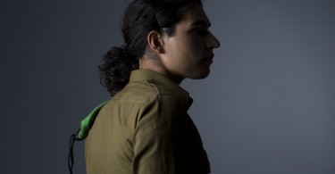 Transgender Israeli IDF soldier, Amy, poses for photos in a studio in Tel Aviv, Israel, Thursday, July 21, 2016. (AP Photo/Oded Balilty)