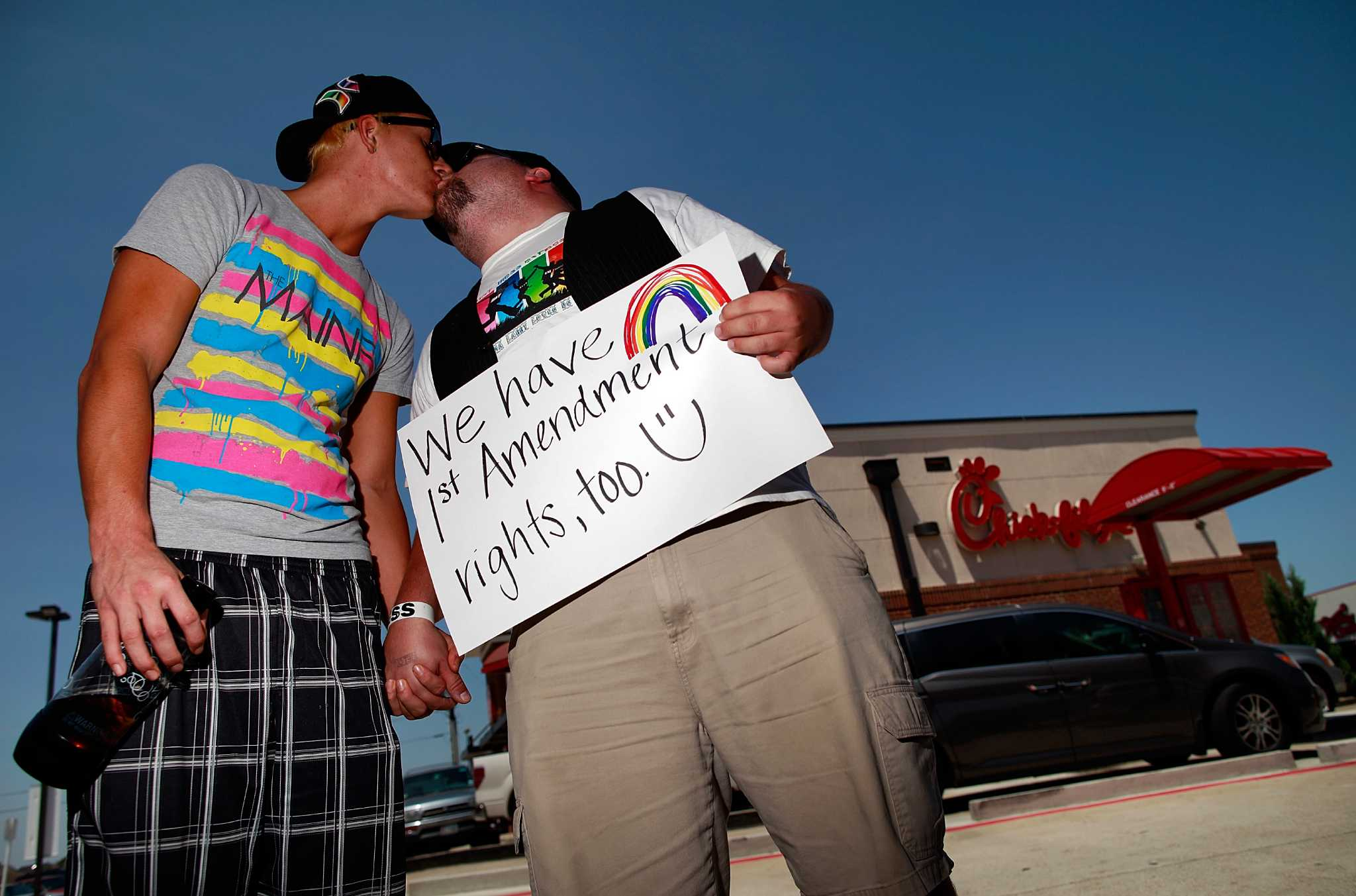 """Gay Rights Activists Hold """"Kiss In"""" In Front Of Chick-Fil-A Restaurant"""
