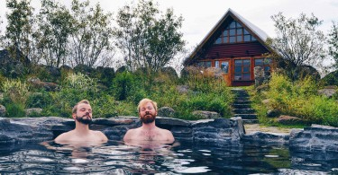 Gay-couple-traveling-road-trip-north-iceland-hestasport-cottages-main