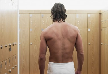 Man standing in locker room in gym