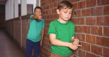 Young-boy-being-bullied-at-school