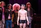 "Actor Darren Criss, front, stands onstage during the curtain call for his ""Hedwig and the Angry Inch"" debut performance at the Belasco Theatre on Wednesday, April 29, 2015, in New York. (Photo by Greg Allen/Invision/AP)"