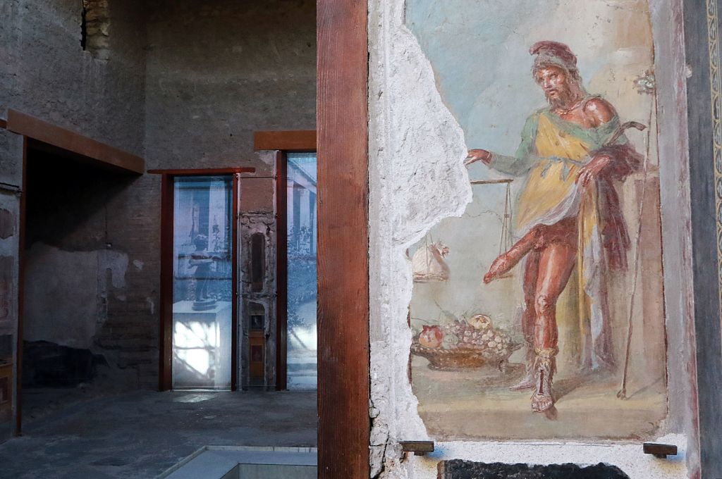 A picture taken on November 16, 2016 shows a fresco in the Vettii's House that re-opened to public after its restoration in the archaeological area of Pompeii. The Roman town of Pompei was buried by the eruption of Vesuvius volcano in 79 DC. / AFP / CARLO HERMANN (Photo credit should read CARLO HERMANN/AFP/Getty Images)