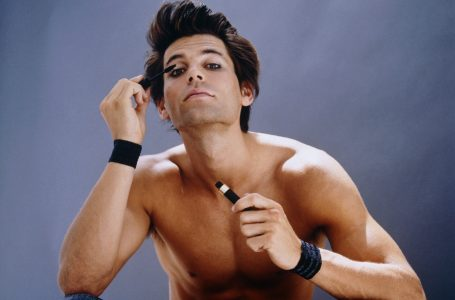 Young Barechested Man Putting on Mascara — Image by © Jean Michel Foujols/Corbis
