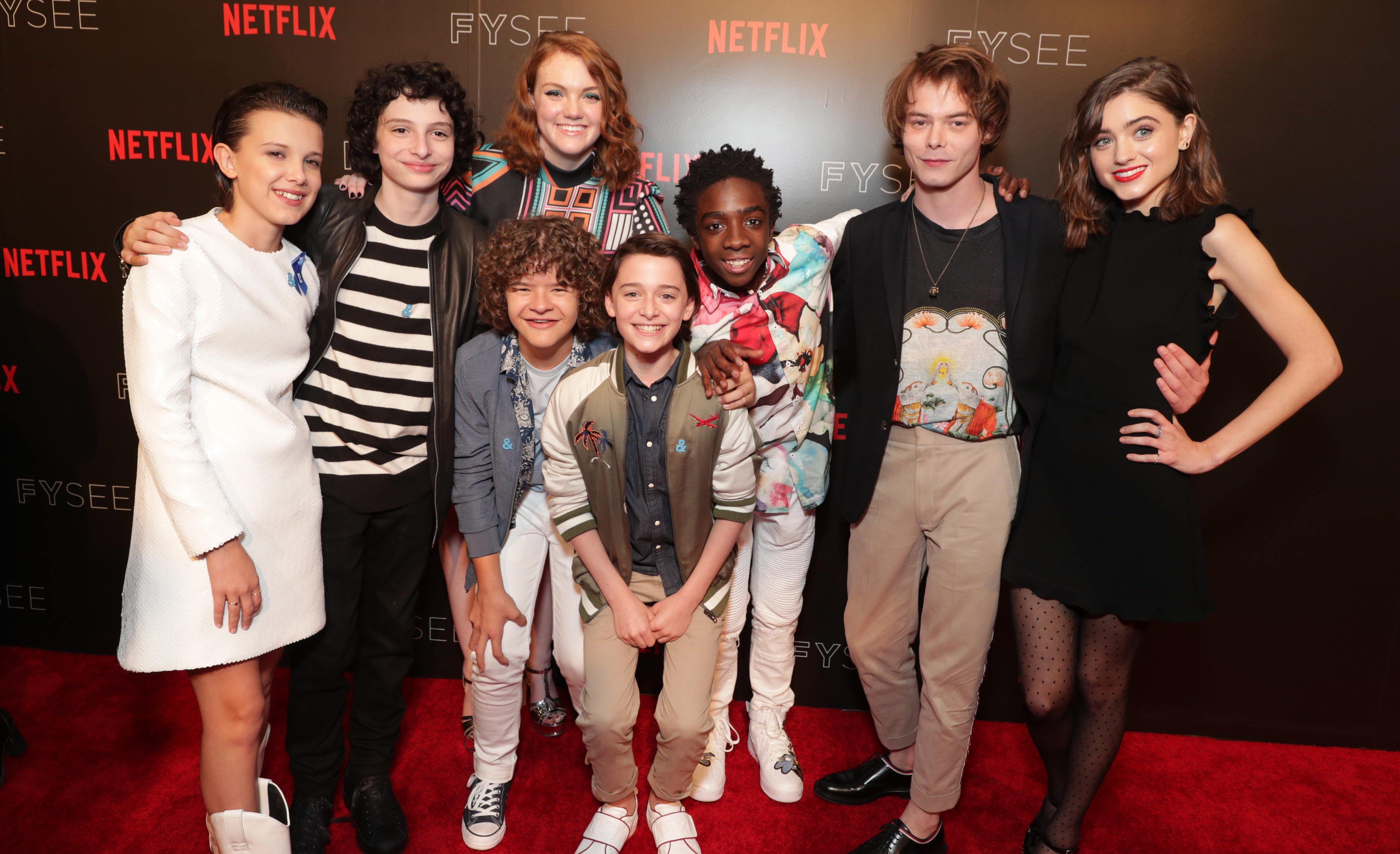 Millie Bobby Brown, Finn Wolfhard, Shannon Purser, Gaten Matarazzo, Noah Schnapp, Caleb McLaughlin, Charlie Heaton and Natalia Dyer seen at Netflix FYSee Kickoff Event, an experiential exhibition space, bringing the best of Netflix series to life for industry and guild members leading into Emmy voting season, on Sunday, May 7, 2017, in Beverly Hills, Calif. (Photo by Eric Charbonneau/Invision for Netflix/AP Images)
