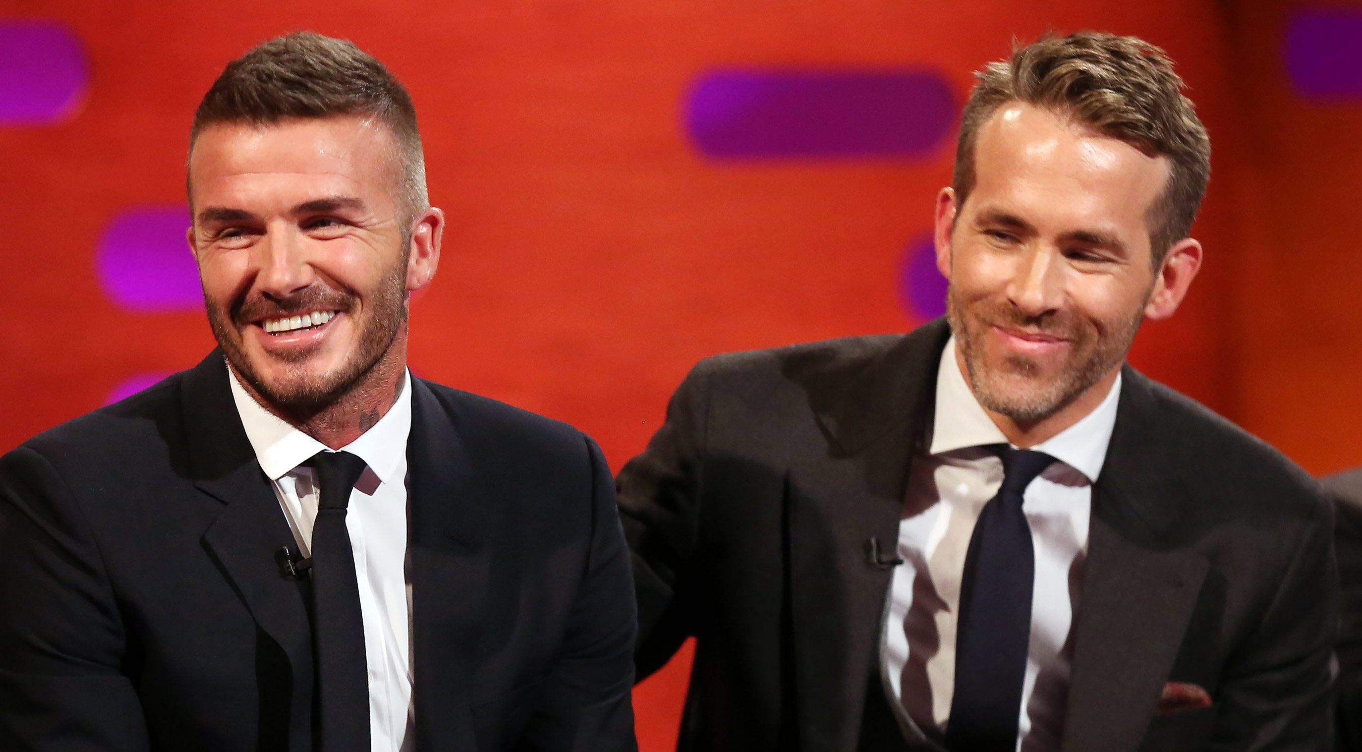 David Beckham (left), and Ryan Reynolds during filming for the Graham Norton Show at BBC Studioworks in London, to be aired on BBC One on Friday. PRESS ASSOCIATION. Picture date: Thursday May 10, 2018. Photo credit should read: PA Images on behalf of So TV (Photo by Isabel Infantes/PA Images via Getty Images)