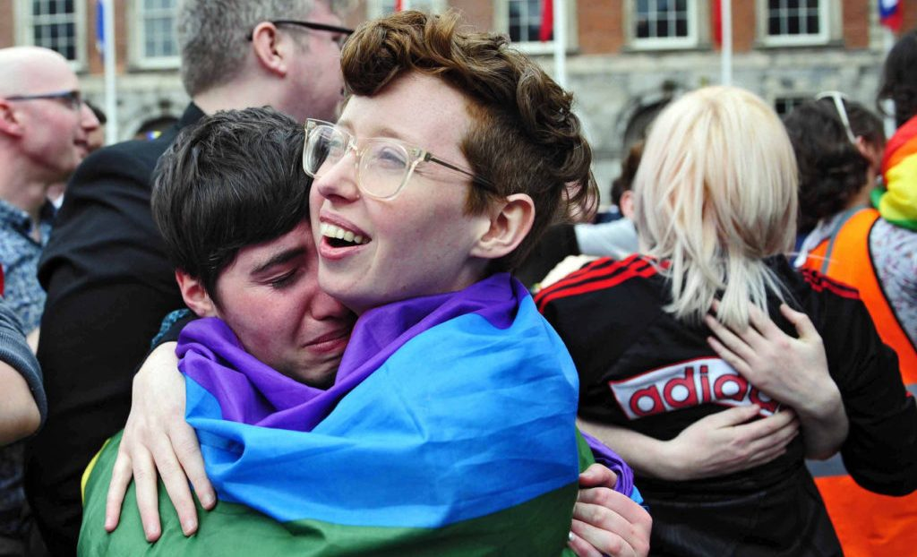 People embrace as the final vote of the referendum on same-sex marriage is announced May 23 in Dublin.  Archbishop Eamon Martin of Armagh, Northern Ireland, president of the Irish bishops' conference, says the church must do more to reach out to gay people. (CNS photo/Aidan Crawley, EPA) See SAMESEX-MARTIN June 2, 2015.
